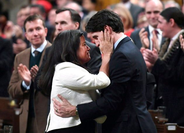 PM Trudeau is embraced by Minister of Justice and Attorney General of Canada Jody Wilson-Raybould on...