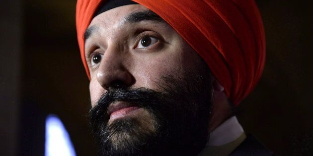 Minister of Innovation, Science and Economic Development Navdeep Bains listens to a question during a...