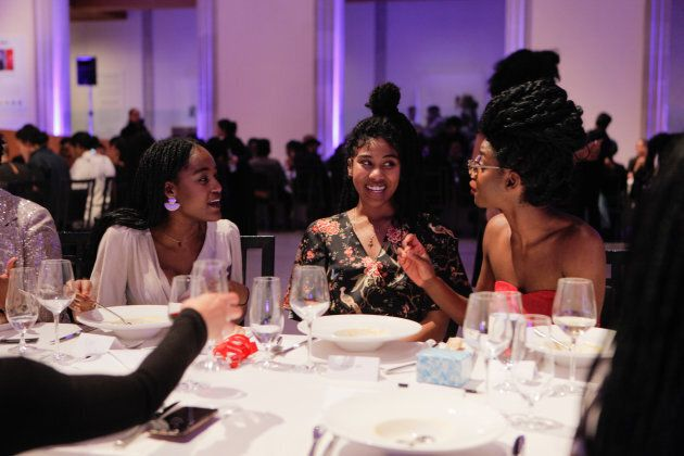 Members of the Black Wimmin Artists advisory committee talk at The Feast. Left to right: Ojo Agi, Raven...