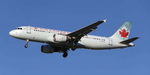 An Air Canada Airbus A320-200 airplane prepares to land at Vancouver's international airport in Richmond,...