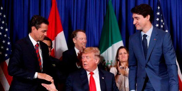 President Donald Trump shakes hands with Mexico President Enrique Pena Nieto, left, as Canada's Prime...