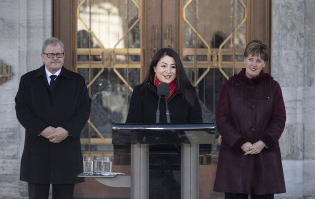 Minister for Women and Gender Equality and Minister of International Development Maryam Monsef speaks to reporters as Minister of Veterans Affairs and Associate Minister of National Defence Lawrence MacAulay, left, and Minister of Agriculture and Agri-Food Marie-Claude Bibeau listen, following a cabinet shuffle at Rideau Hall in Ottawa on March 1, 2019.