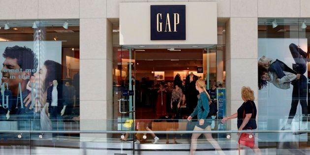 People walk by a Gap store in Pittsburgh on Aug. 31, 2017. The Gap plans to close almost half its