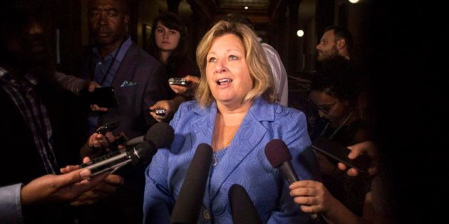 Lisa Thompson scrums with reporters following Question Period on Aug. 9,