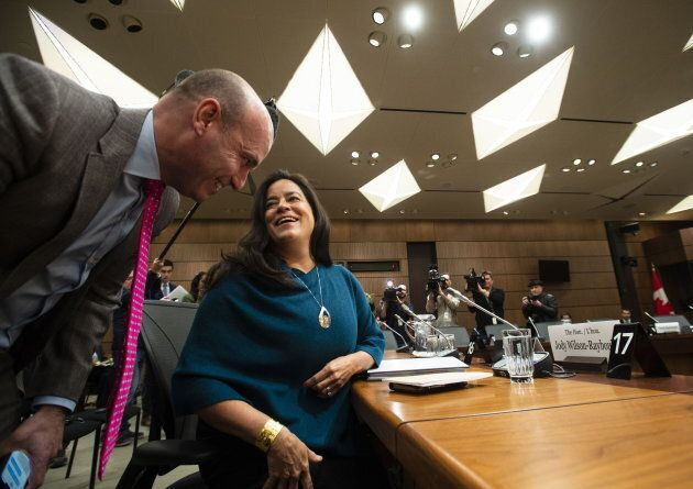 NDP MP Nathan Cullen speaks to Jody Wilson-Raybould as she arrives to appear at the House of Commons Justice Committee on Parliament Hill in Ottawa on Feb. 27, 2019.