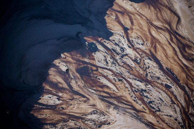 The Suncor Energy Inc. Steepbank mine is seen in this aerial photograph taken above the Athabasca oil...