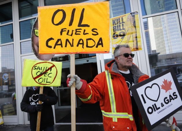 Oil and gas supporters picket outside the National Energy Board, during the release of the board's reconsideration...