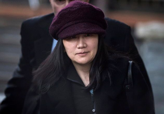 Huawei chief financial officer Meng Wanzhou leaves her home to attend a court appearance in Vancouver,...