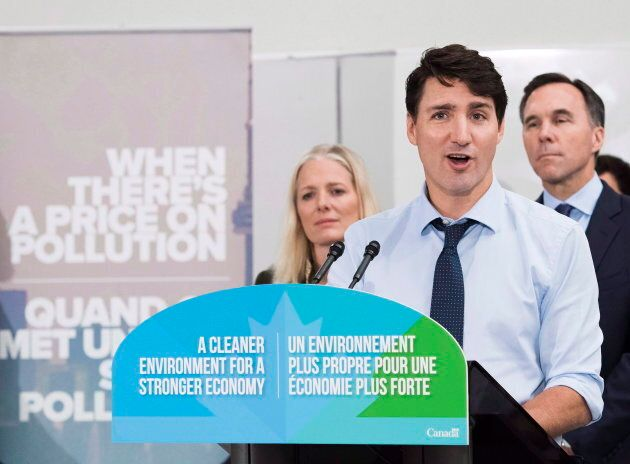 Trudeau speaks to the media and students about the federally-imposed carbon tax in Toronto on Oct. 23,
