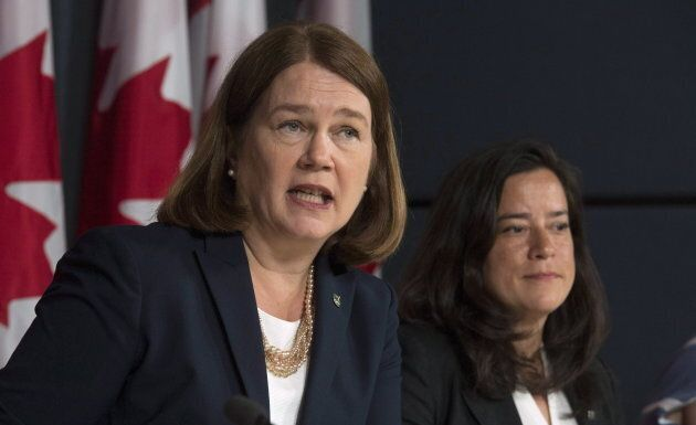Jane Philpott responds to a question Jody Wilson-Raybould looks on during a news conference in Ottawa...