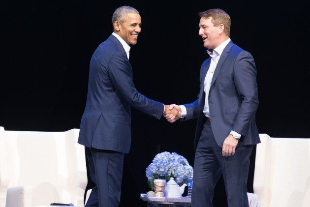 Obama and Michael Burns, CEO of the Princess Margaret Cancer Foundation, shake hands at the Bell MTS...