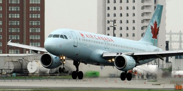 An Air Canada Airbus A320 lands on a runway at Pearson International Airport in Toronto in
