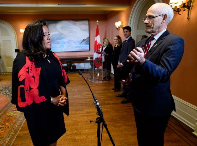 Prime Minister Justin Trudeau looks on as Jody Wilson-Raybould becomes veterans affairs minister at Rideau Hall in Ottawa on Jan. 14, 2019.