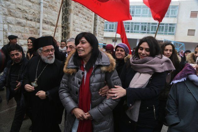 Khalida Jarrar (centre) is welcomed by her supporters and relatives after she was released from detention that lasted 20 months, in front of her house in Nablus, West Bank on Feb. 28, 2019.