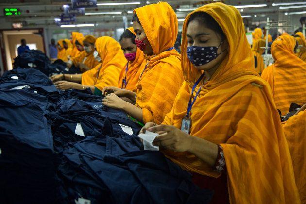 Workers at a garment factory work at MB Knit garment factory in Narayanganj, near Dhaka, Bangladesh.