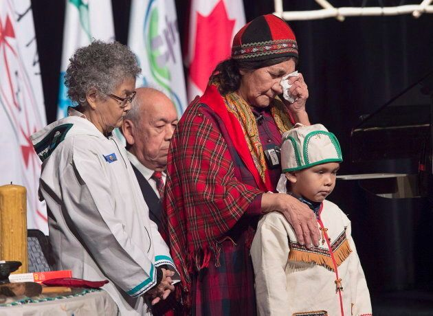 Elders offer prayers before Prime Minister Justin Trudeau delivered an apology on behalf of the Government...