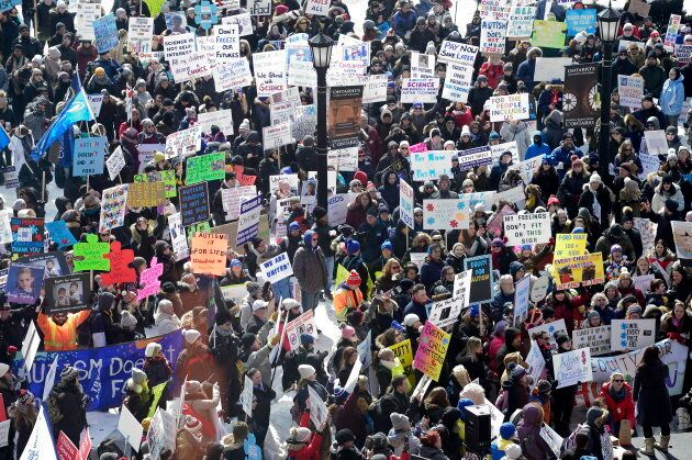 Hundreds of parents, therapists and union members gather outside Queen's Park in Toronto on March 7, 2019, to protest the provincial government's changes to Ontario's autism funding.