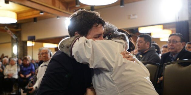 Prime Minister Justin Trudeau is greeted by an Inuit Elder prior to delivering an official apology to...