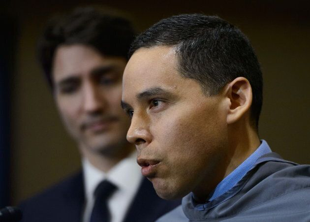 Prime Minister Justin Trudeau looks on as Natan Obed, President of the ITK, speaks during a press conference...