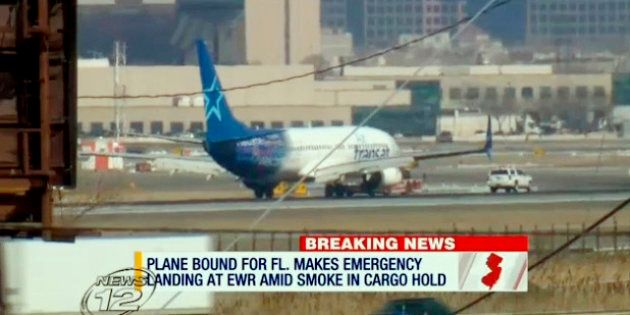 In this image taken from video provided by News12 New Jersey, Air Transat Flight 942 is towed along the...