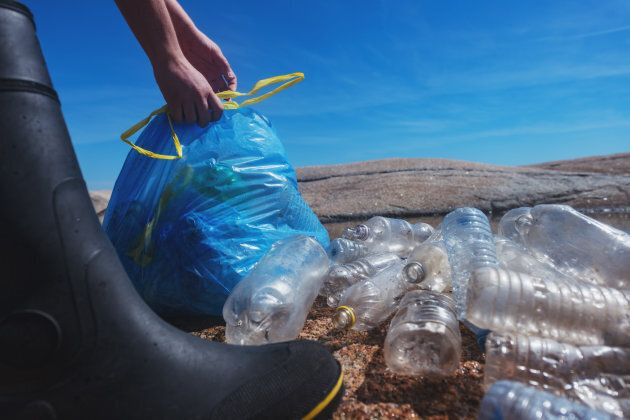 A volunteer collecting plastic waste from the Atlantic