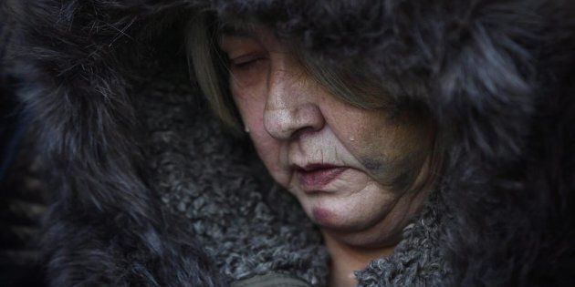 Thelma Favel, Tina Fontaine's great-aunt and the woman who raised her, sheds tears during a march the...