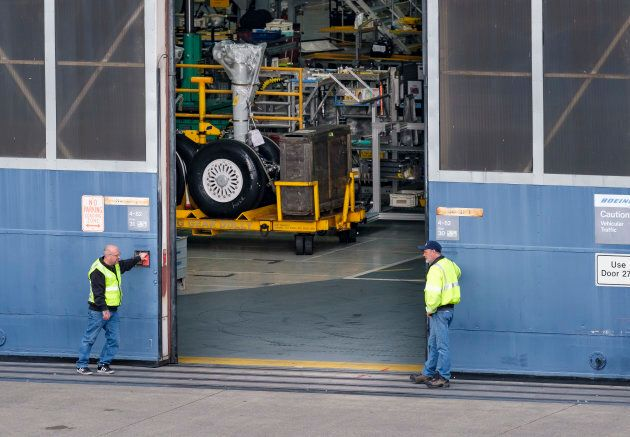 The door to the Boeing 737 factory closes on March 11, 2019 in Renton,