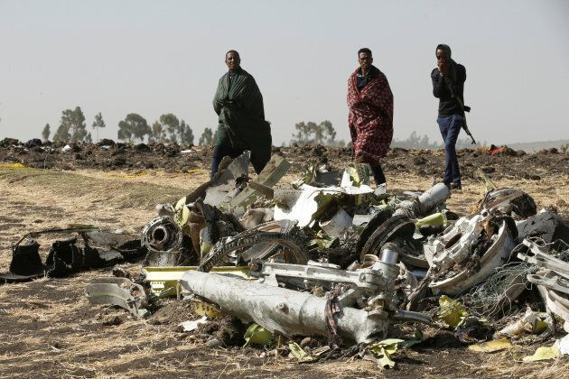 Police officers walk past the debris of the Ethiopian Airlines Flight ET 302, near the town of Bishoftu,...