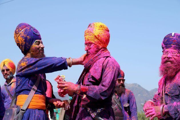 Nihang Sikhs seen playing Holi during the annual fair of Hola Mohalla in Punjab,