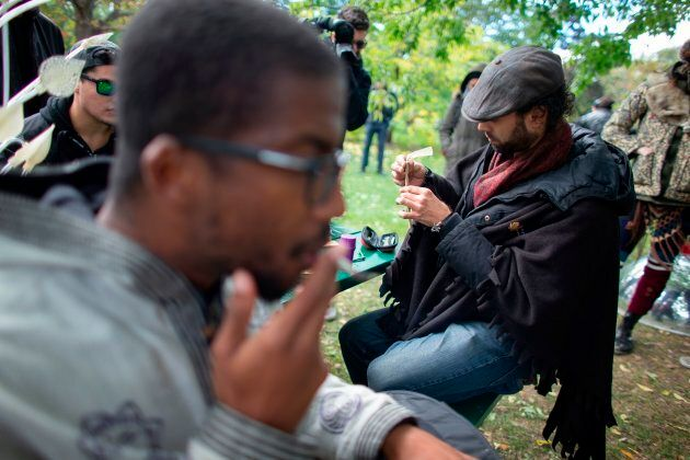 A man rolls a marijuana cigarette during a legalization party  in Toronto on October 17, 2018 — the day nearly a century of marijuana prohibition came to an end.