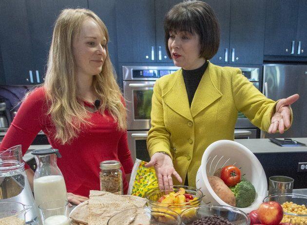 Health Minister Ginette Petitpas Taylor, right, and nutritionist Jessica Cole look over samples of some of the food groups at the unveiling of Canada's new Food Guide on Jan. 22, 2019 in Montreal.