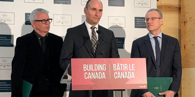 Minister Jean-Yves Duclos (centre), responsible for Canada Mortgage and Housing Corporation, announces...