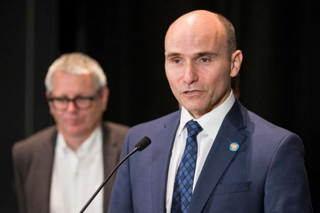 Jean-Yves Duclos, minister of families, speaks to the media at a the Toronto Housing Summit on Sept. 30, 2016.