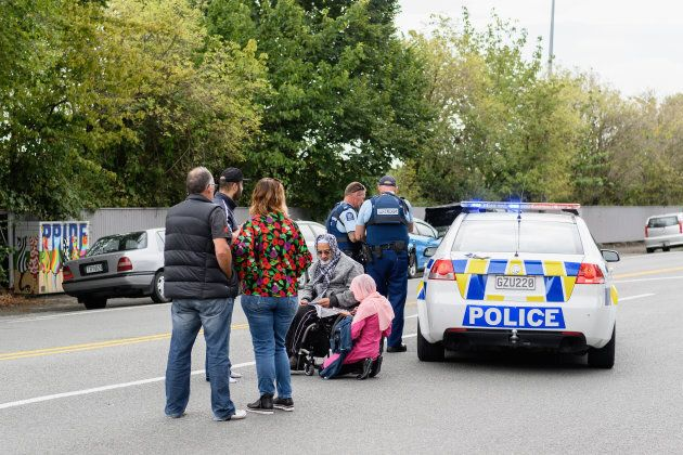 Members of the public react in front of the Masjd Al Noor Mosque as they fear for their relatives on March 15, 2019 in Christchurch, New Zealand.