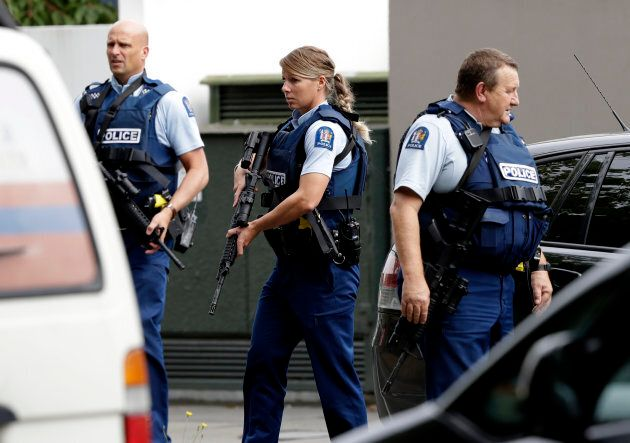 Armed police patrol outside a mosque in central Christchurch, New Zealand on Friday.