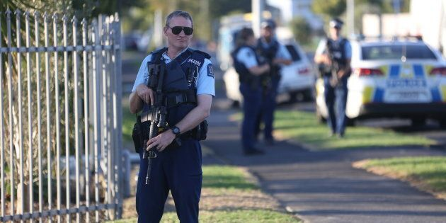 Armed police guard the Masijd Ayesha Mosque Auckland, New Zealand on March 15, 2019 following two shootings...