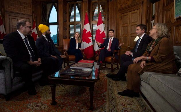 Bloc interim leader Mario Beaulieu (left), NDP leader Jagmeet Singh, Tourism Minister Melanie Joly, Conservative Leader Andrew Scheer and Green Party leader Elizabeth May listen as Prime Minister Justin Trudeau delivers opening remarks on francophone issues in his Ottawa office on Nov. 28, 2018.