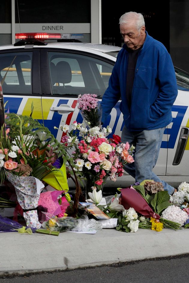 A men places flowers at a makeshift memorial near the Masjid Al Noor mosque in Christchurch, New Zealand.
