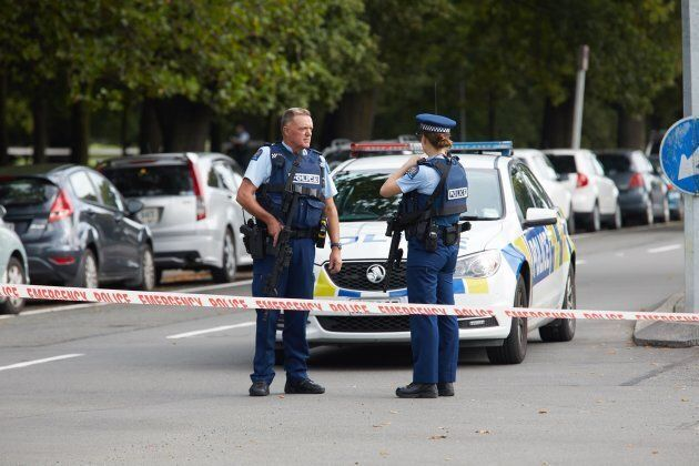Police officers cordon off the area after gunmen attacked the two mosques and fired multiple times during...