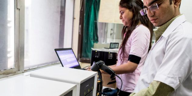 Using a GeneXpert machine in a CBNAAT laboratory at the Surat Municipal Institute of Medical Education & Research (SMIMER), Surat. The Genexpert test detects the presence of TB bacteria DNA in a patient sample.