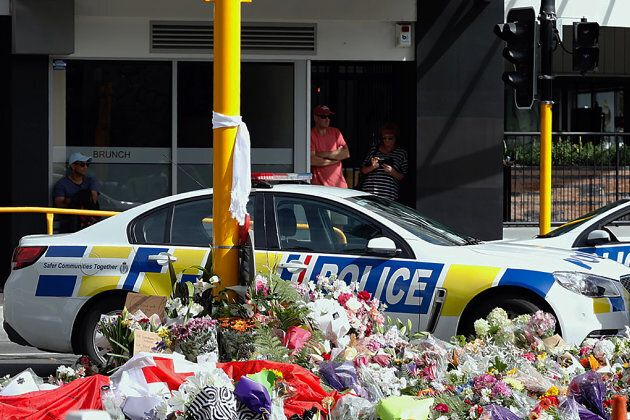 Residents pay respect by placing flowers for the victims of the mosques attacks in Christchurch on