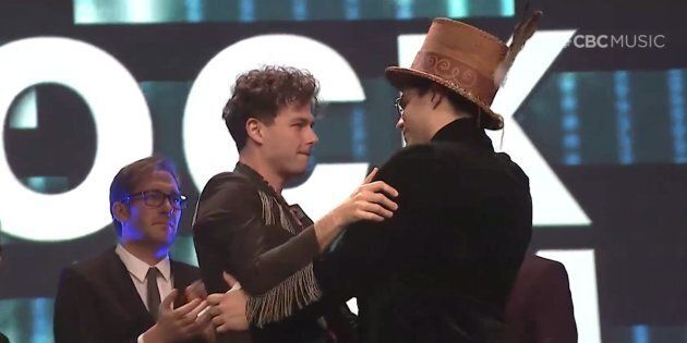 Arkells singer Max Kerman embraces musician Jeremy Dutcher at the Junos gala dinner and awards on March...