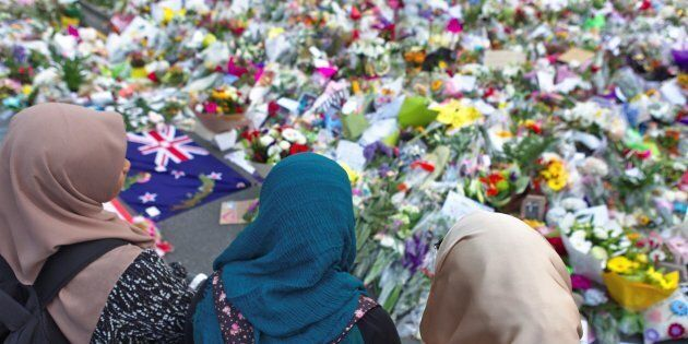 A group of women pay tribute to the victims of the mosque attack at the botanic garden memorial, in Christchurch,...
