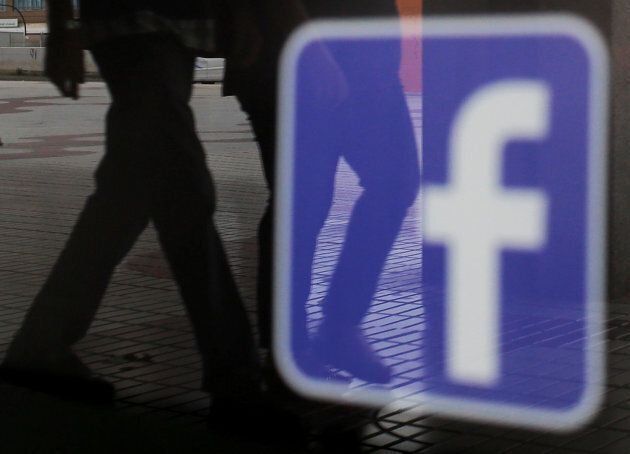 The Facebook logo is seen on a shop window in Malaga, Spain on June 4,