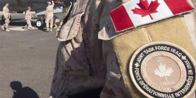 A member of the Canadian Forces stands on tarmac at the Canadian Forces base in the Persian Gulf on Feb....