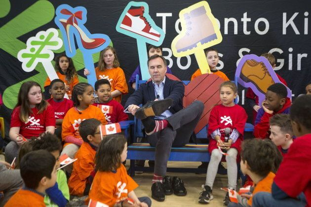 Federal Finance Minister Bill Morneau puts on his budget shoes in a pre-budget photo opportunity in Toronto...