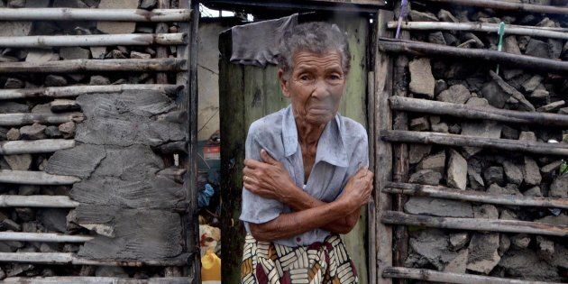 A shivering displaced woman is portrayed in the doorframe of a house in Beira on March 19, 2019. More...