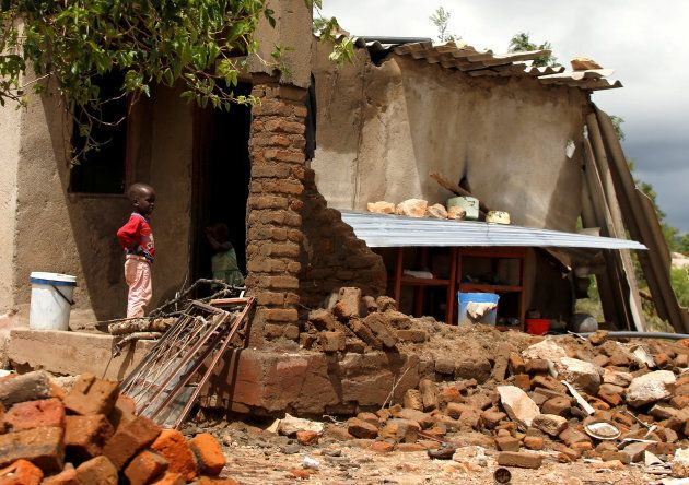 A boy looks on at a family home destroyed by floods following Cyclone Idai in Chimanimani district, Zimbabwe, on March 18, 2019.