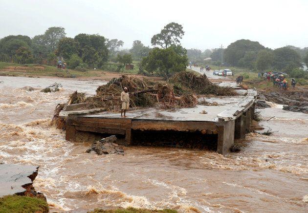 A man looks at a washed away bridge along Umvumvu river following Cyclone Idai in Chimanimani, Zimbabwe on March 18, 2019.