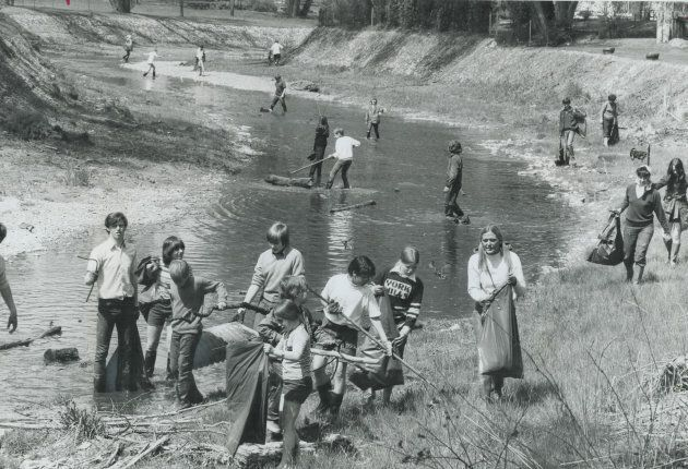 Teenagers sweep the filthy, stinking west branch of Toronto's Don River for garbage in 1971.